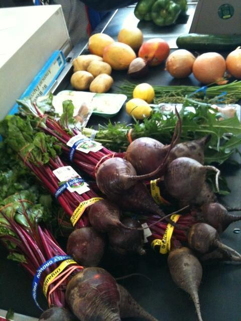 My purchases at the market today: Beets and dandelion greens.