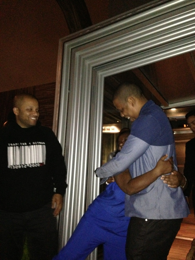 There's Jay Z, hugging on his friend at her birthday party. Nice to meet you, Jigga!